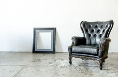Black genuine leather classical style sofa in vintage room. With frame Stock Images