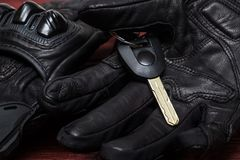 Black Genuine leather Motorcycle Glove with High Security Motorc. Ycle Chip Key on Wooden Background Stock Photos