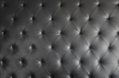 Black genuine leather sofa pattern as background Stock Photography