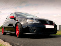 Black German Sportscar. A black german sportscar running on the electric power grid Stock Images
