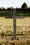 Black german war cross. Close view of a black cross in a german war cemetery in France stock photo