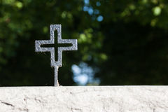 Black german war cross. Close view of a black cross in a german war cemetery in France with nice bokeh Royalty Free Stock Photography