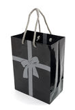 Black gift bag. Black paper gift or shopping bag isolated on white Royalty Free Stock Photography