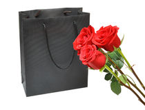 Black gift bag with red roses Stock Photography