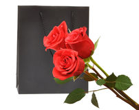 Black gift bag with red roses Royalty Free Stock Photos