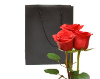 Black Gift Bag With Red Roses Stock Photo