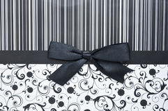 Black gift bow on black seamless pattern Stock Photo