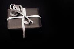 Black gift box black background. Royalty Free Stock Image