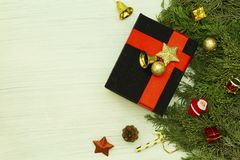 Black gift box and christmas decorations on white background. royalty free stock photos
