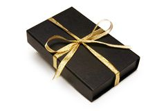 Black Gift Box with Gold Ribbon. Against White background Stock Image
