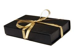 Black Gift Box with Gold Ribbon. Against White background Royalty Free Stock Image