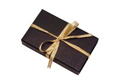 Black Gift Box with Gold Ribbon. Against White background Royalty Free Stock Images