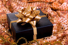 Black gift box with gold ribbon. Stock Image