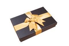 Black gift box with gold ribbon and a bow on white background Royalty Free Stock Images