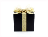 black gift box with golden ribbon and shining net bow isolated on white background Royalty Free Stock Image