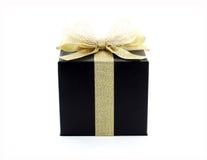 Black gift box with gold ribbon Royalty Free Stock Image