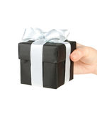 Black gift box in hand. Isolated on white Royalty Free Stock Images