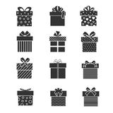 Black gift box icons. Presents signs with ribbons and bows Stock Images