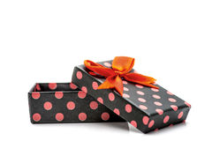 Black gift box with pink dots and orange ribbon Royalty Free Stock Image