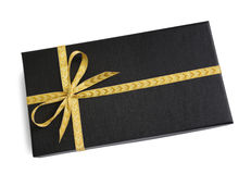 Black gift box (present) with golden ribbon bow Royalty Free Stock Image