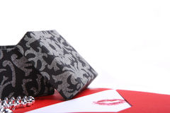 Black gift box with a red envelope Stock Images