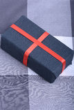 Black gift box with red ribbon Royalty Free Stock Photos
