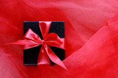 Black gift box with red ribbon Royalty Free Stock Image