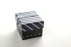 Black gift box with ribbon and blue lines Stock Photography