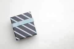Black gift box with ribbon and blue lines Top Royalty Free Stock Photo