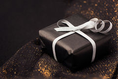 Black gift box on shiny background. Stock Photo