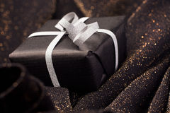 Black gift box on shiny background. Stock Photography