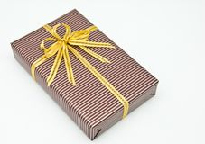 Black gift box with white bar attached gold ribbon Stock Photo