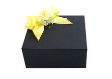 Black gift box with yellow bow Stock Image