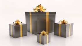 Black gift boxs with golden ribbon bow on the light background royalty free stock image
