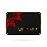 Black gift card template with red ribbon and a bow. Stock Photo