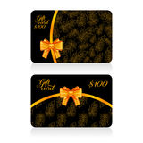 Black gift cards with golden decor feather pattern and bow Royalty Free Stock Photos