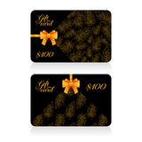 Black gift cards with golden decor feather pattern and bow Royalty Free Stock Photography