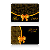 Black gift cards with golden decor feather pattern and bow. Vector illustration for your design Royalty Free Stock Photography