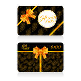 Black gift cards with golden decor feather pattern and bow. Vector illustration for your design Royalty Free Stock Photo