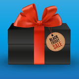 Black gift with red bow Stock Photos