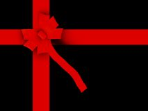 Black gift with red ribbon Stock Photos