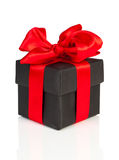 Black gift with red ribbon. On white background Stock Photos
