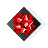 Black gift top view with red bow Stock Photo