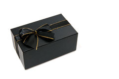 Black giftbox. With a black and gold knot white isolated Royalty Free Stock Photography