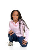 Black girl with corn rows sitting Royalty Free Stock Photos