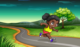 A Black girl jogging Stock Images