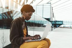 Black girl with laptop outdoors royalty free stock photos