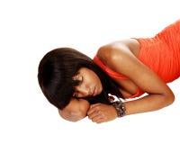 Black girl lying on floor. Stock Photo