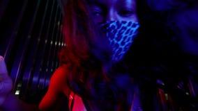 Black Girl In Mask To Protect Against Viruses. She Dances Modern Dance.