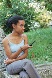 Black girl with mobile phone Royalty Free Stock Photos